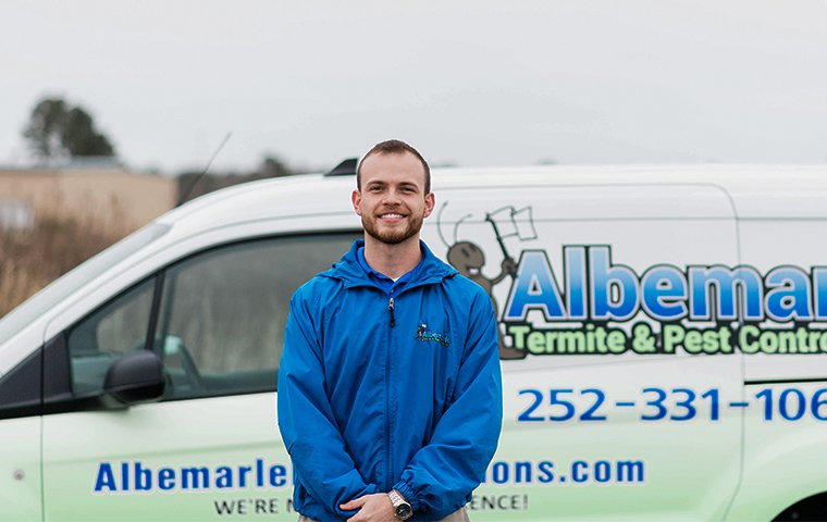 business manager of albemarle stands in front of branded vehicle