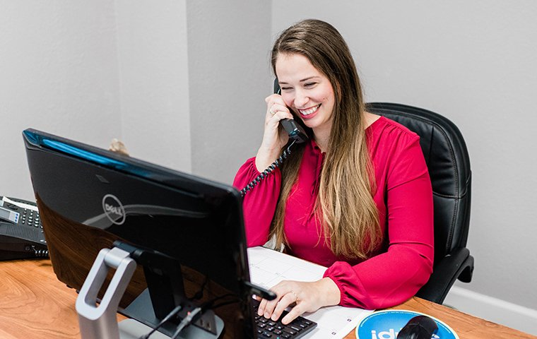 customer care specialist sits at desk