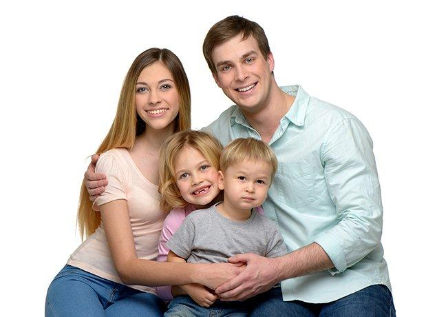 a smiling family of four in elizabeth city north carolina