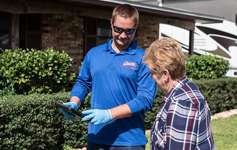 technician speaking to homeowner