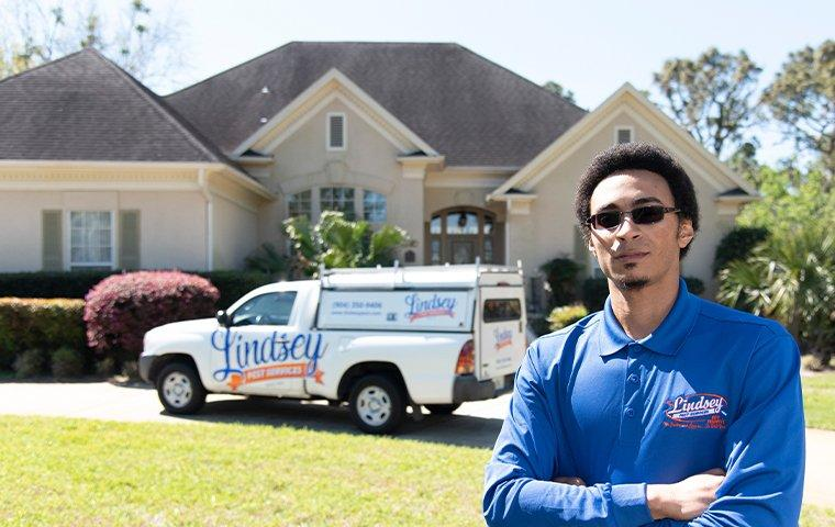 a technician standing outside of a bryceville florida home