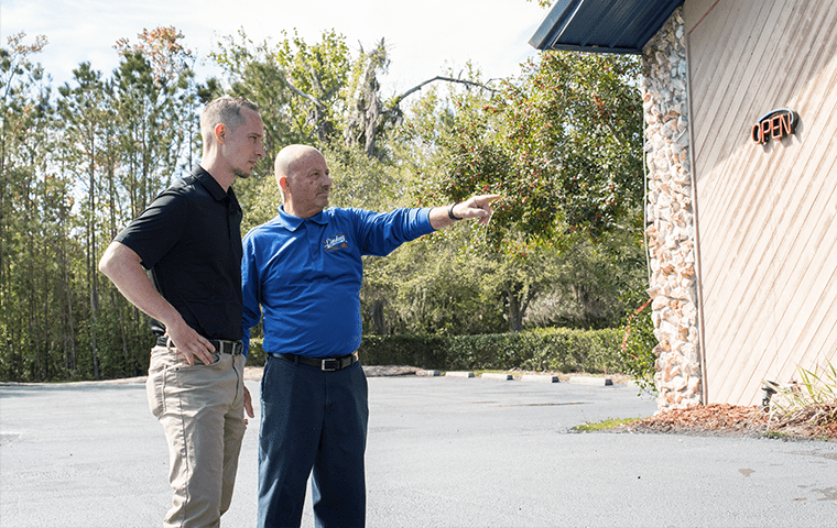 a technician talking with a customer in jacksonville florida