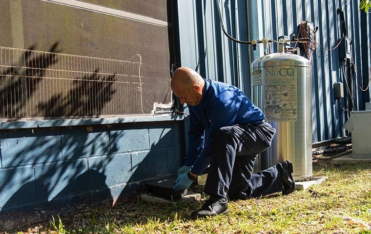 a technician treating a san marco florida facility