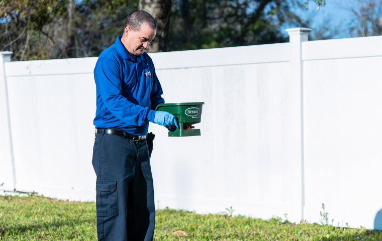a technician performing an exterior treatment in jacksonville florida
