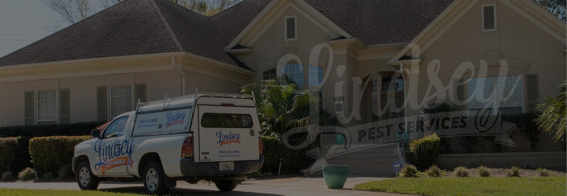 a lindsey pest service pest control truck outside of a jacksonville beach home