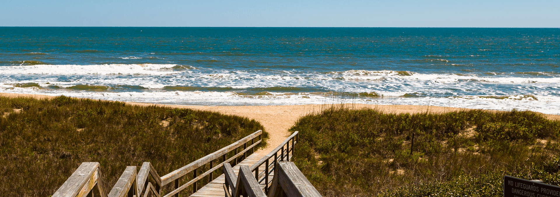 a walkway leading to the ocean in ponte vedra beach florida