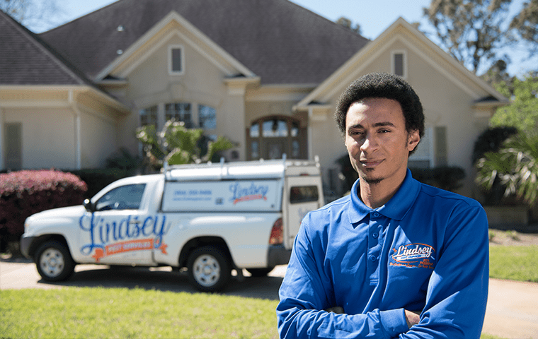 a technician standing outside of an atlantic beach florida home