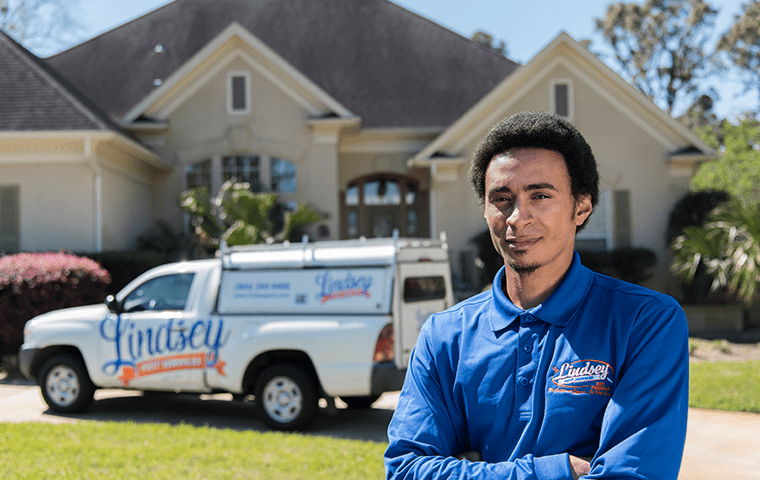 a pest technician standing outside of a ponte vedra beach florida home