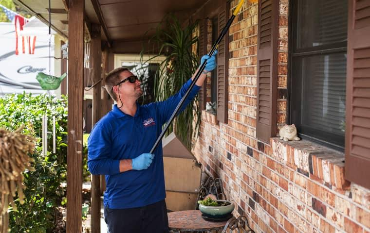 a technician servicing a palm valley florida home