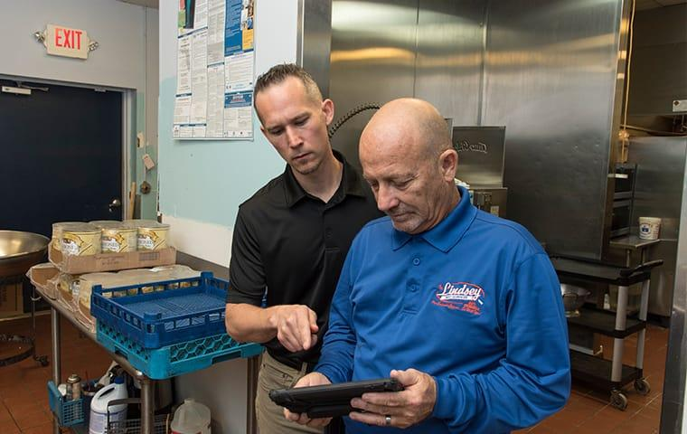 a lindsey technician meeting with a client in a st augustine beachflorida commercial kitchen