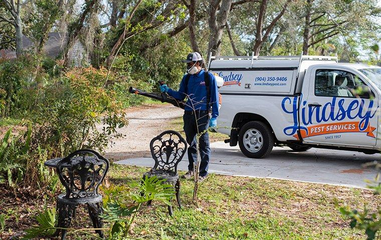 a technician spraying for mosquitoes in vilano beach florida