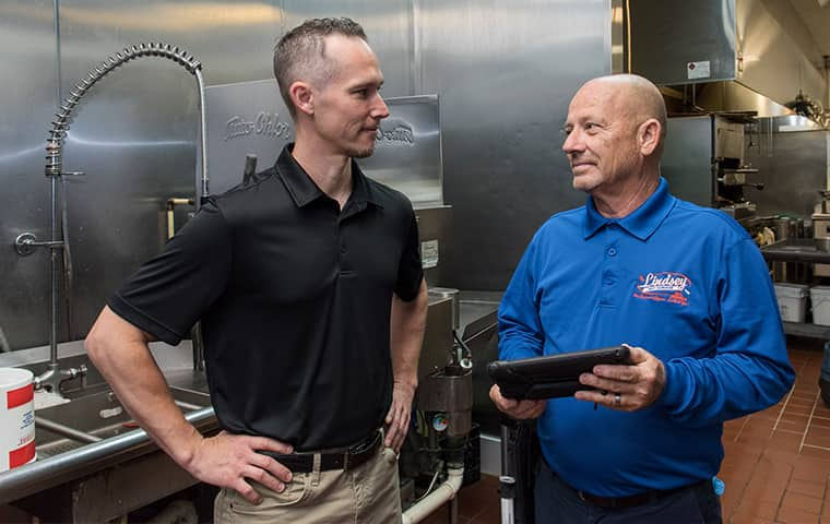 a lindsey technician meeting with a commercial business owner in yulee florida