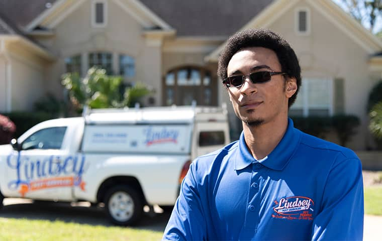 a technician standing in front of a yulee florida home