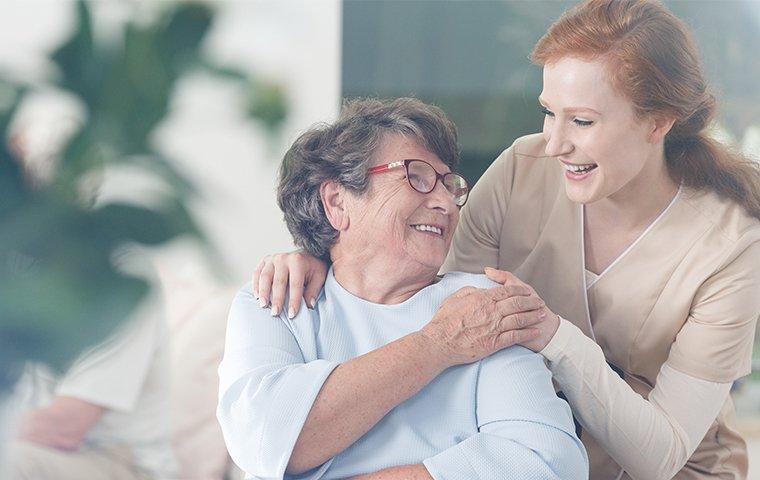 a friendly nurse and an elderly woman