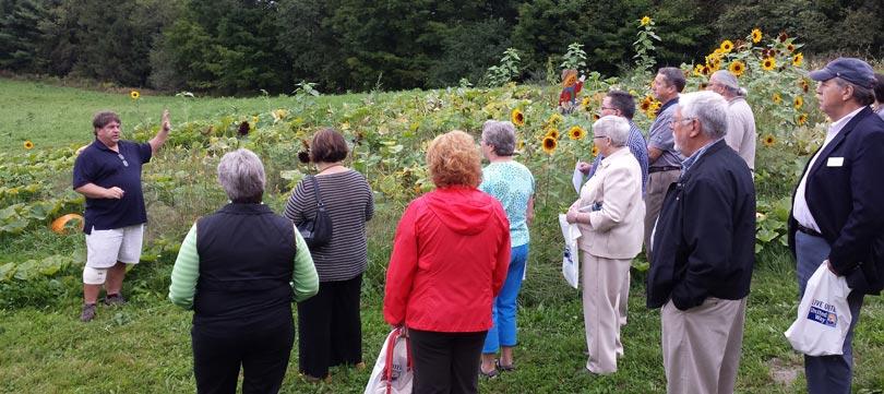 Caravan of Caring participants visit LEAP's Stone Soup Gardens