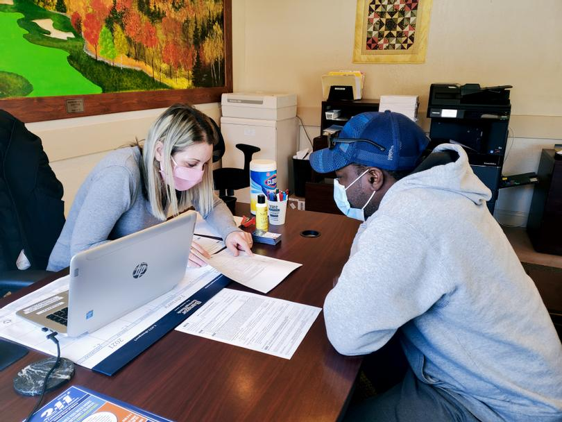 Volunteer Tax Preparer assists Marlon Service with his taxes