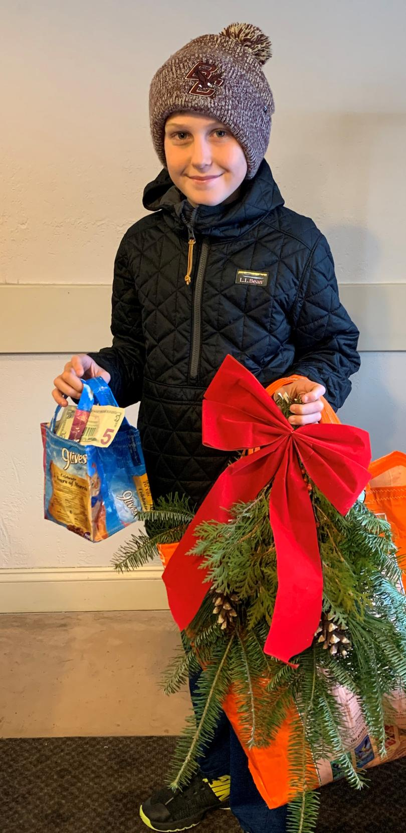 Reed Potter received funding through the Hope Fund to buy a pig and raise it through 4-H. He was so appreciative he sold grain bags and Christmas swags that he had made and donated $100 back to the Hope Fund!