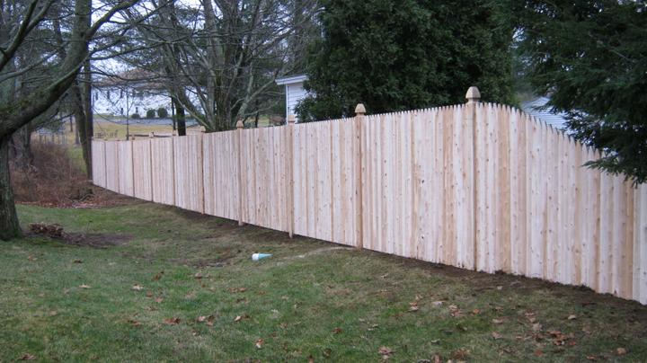 Photo #131, 6' Stockade Picket with Gothic Top Posts and Slope