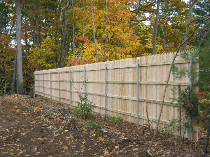 Photo #144, 8' Stockade with Pressure Treated Rails and Steel Posts