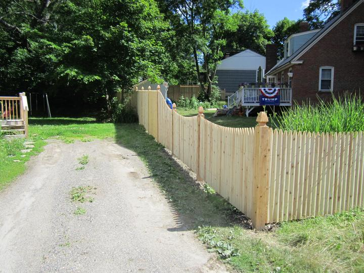 Photo #145, 6' Solid Stockade Picket with Slope to 4' Scalloped Stockade