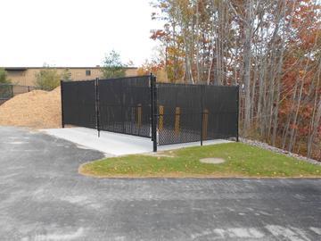 Photo #339, Black Vinyl Chain Link Dumpster Enclosure with Privacy Slats