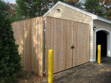 Photo #344, 8' Solid Board Dumpster Enclosure with Thin Cap Strip and Steel Gate Frame