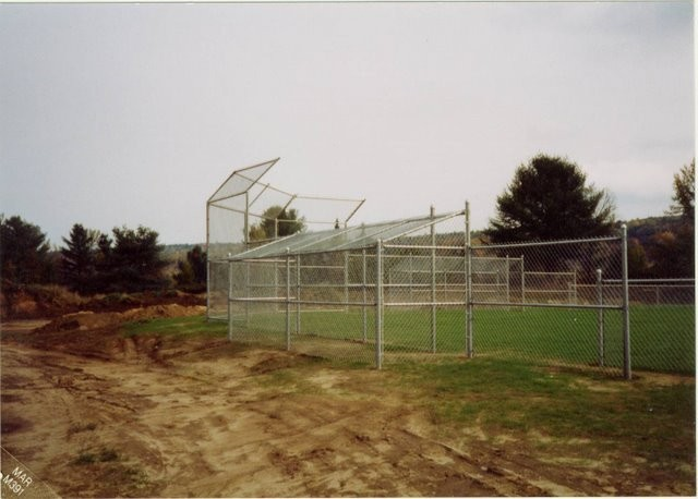 Photo #50, Galvanized Chain Link Back Stop with Overhang and Chain Link Dugout