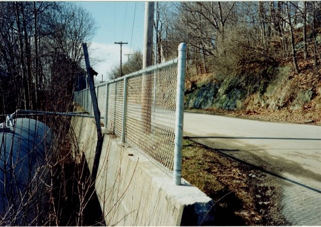 Photo #73, 3' Galvanized Chain Link with Posts Mounted into Concrete Barriers