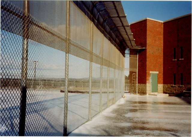 Photo #59, Prison Fence with 6' Galvanized Fabric on Bottom and Wire Mesh on Top
