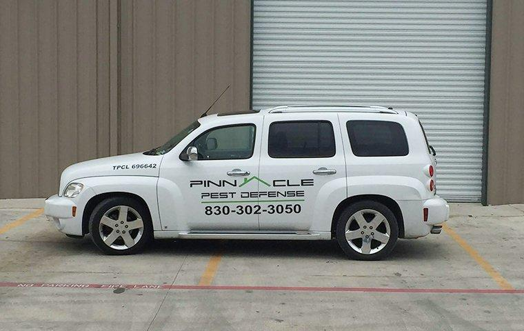 pinnacle pest defense vehicle near a commercial building