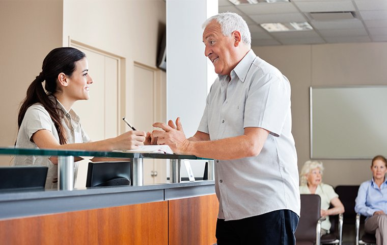 a nice receptionist talking with an older man