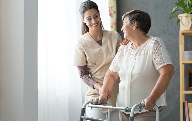 a nurse helping an elderly woman