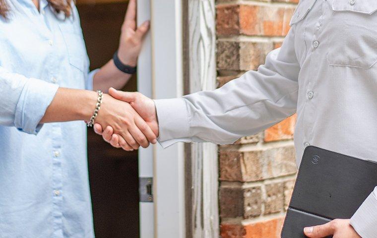 tech greeting homeowner