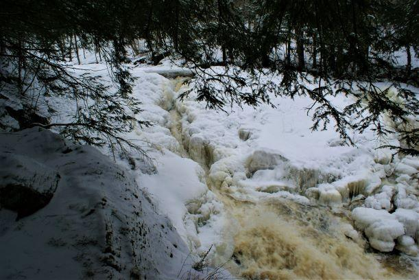 The falls is nearly covered with ice (Credit: Wm Hill/Hiking the trail to yesterday)