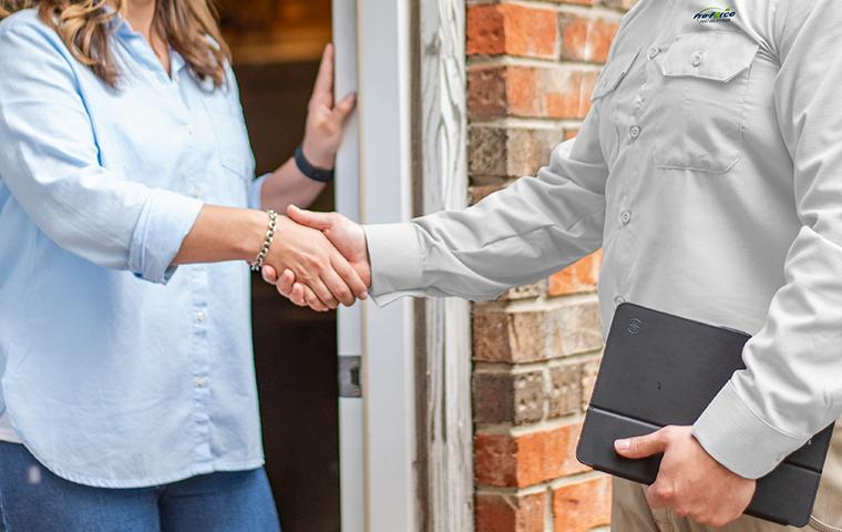 technician shaking hands with client