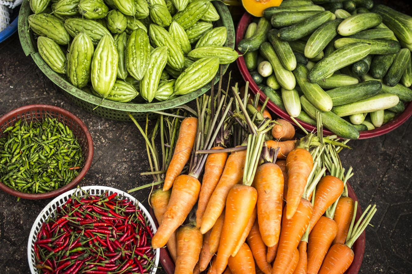 Baskets of carrots, cucumbers and vegetable farm