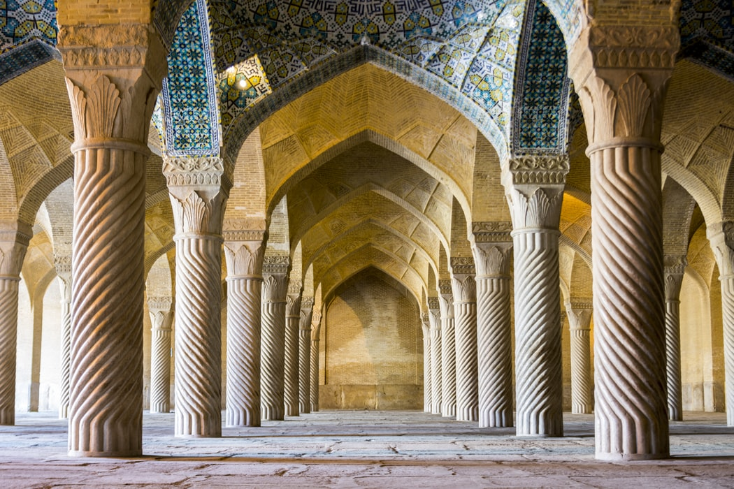 Two parallel pillars in a row at the Vakil Mosque in Iran