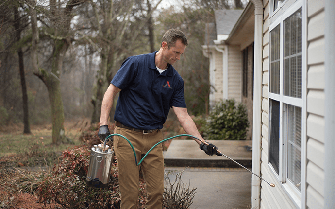 home pest control technician treating cherryville home