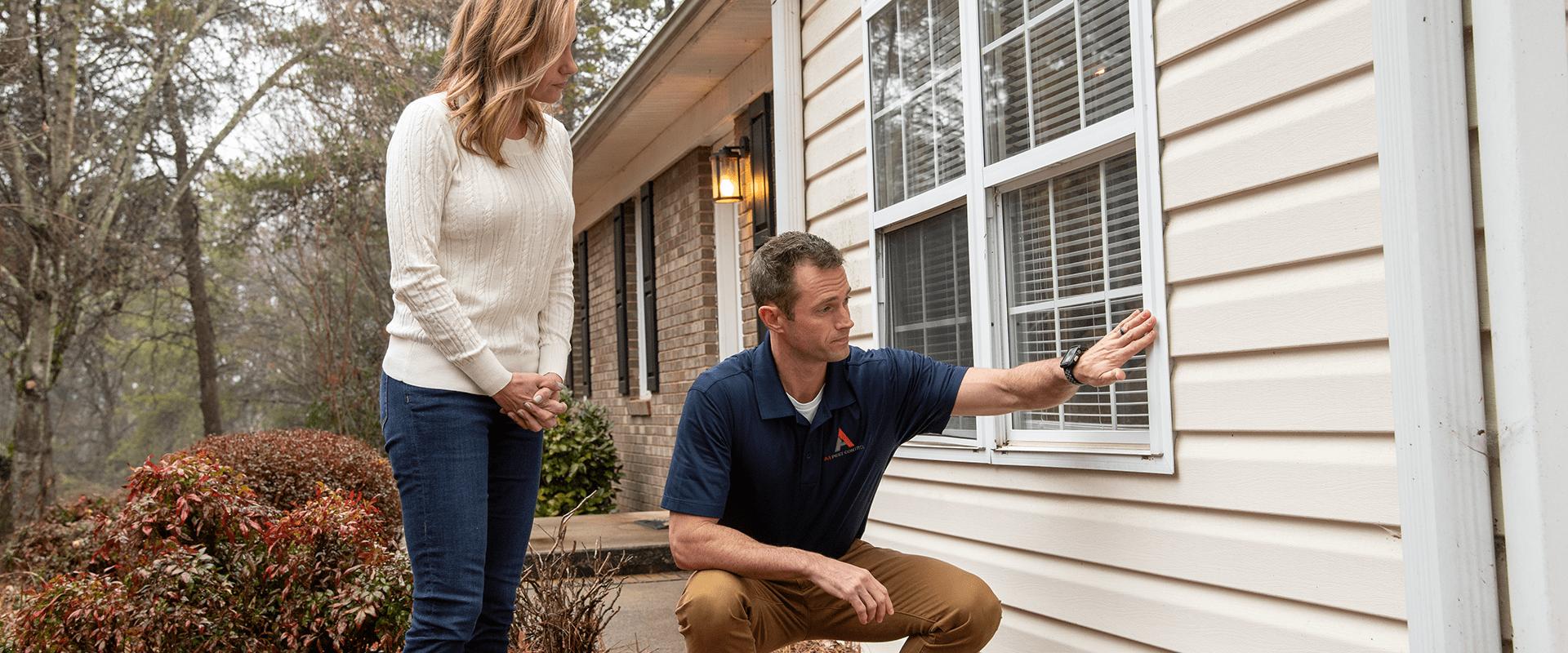 termite control technician with homeowner