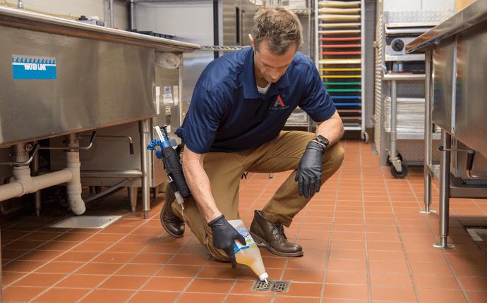 technician implementing commercial pest control plan