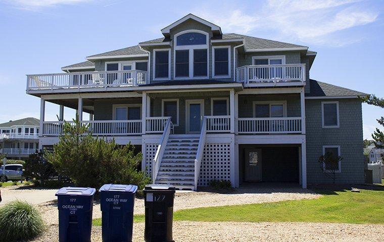 a large gray house in holden beach north carolina