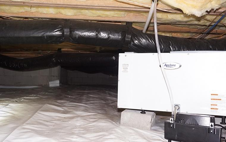 a dehumidifier package in the crawlspace of a home