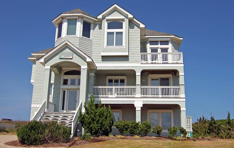 a large gray house in oak island north carolina