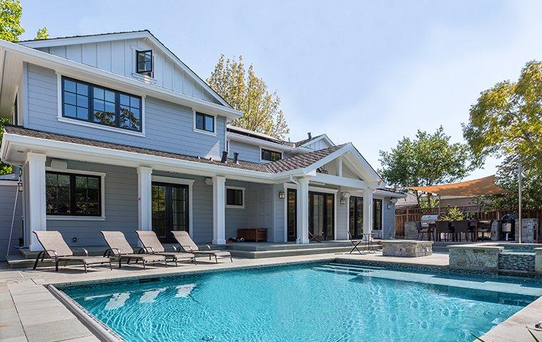back yard with a pool and home in alhambra california