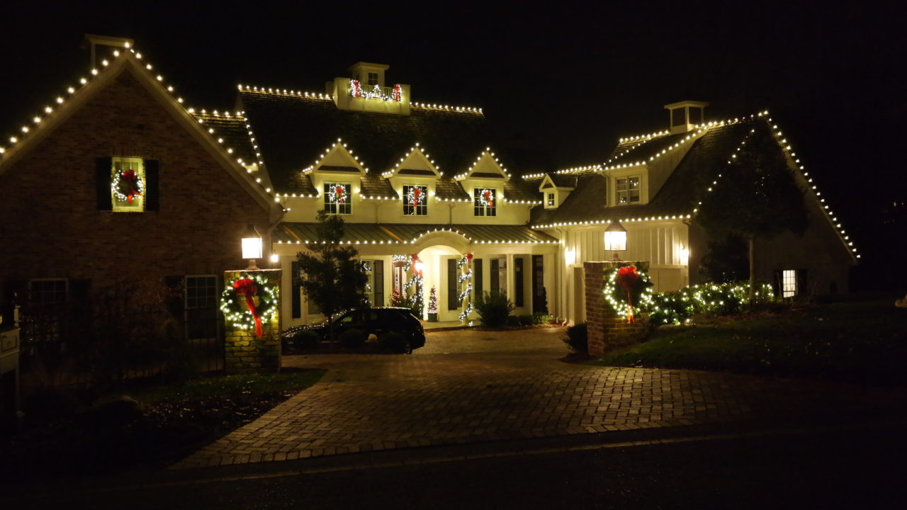 street view of a house decorated with christmas lights