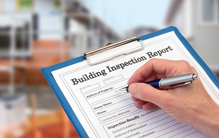 building inspection report on clipboard