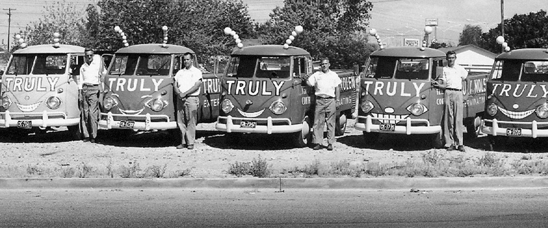 black and white photo of early truly nolen vehicles