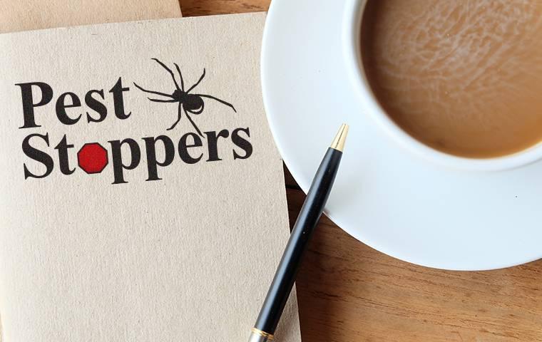 folder with company logo and coffee