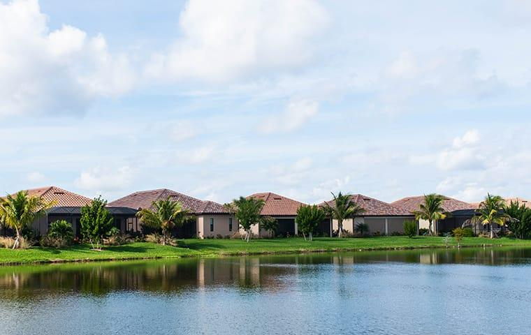 a row of condos lined up along a florida waterfront community complex