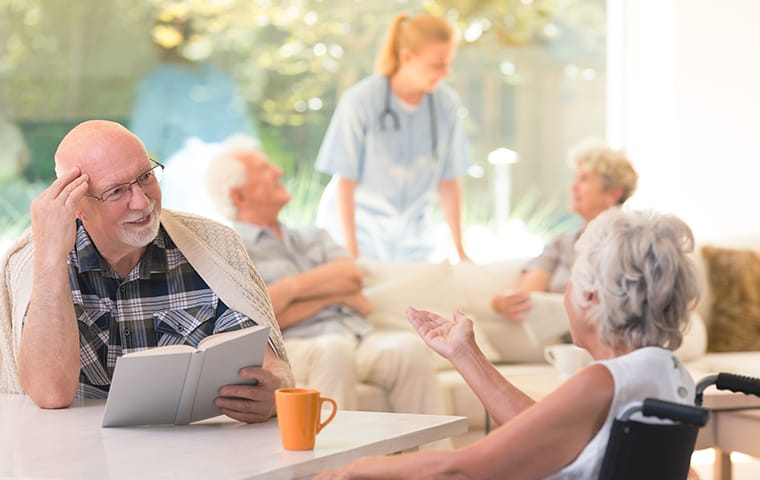 residents of an assisted living facility sitting at a table in boca raton florida